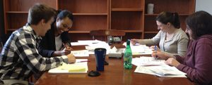 Brian, Divine, Christy, Jenny working in conference room, 2014